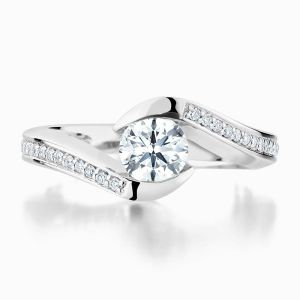Front View of the Ecksand Twisted Round Cut Diamond Solitaire Engagement Ring with Diamond Band