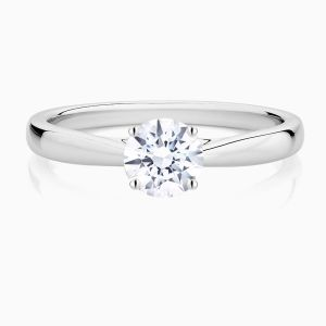Front View of the Ecksand Secret Heart Tapered Round Cut Diamond Solitaire Engagement Ring with Secret Heart and Tapered Band