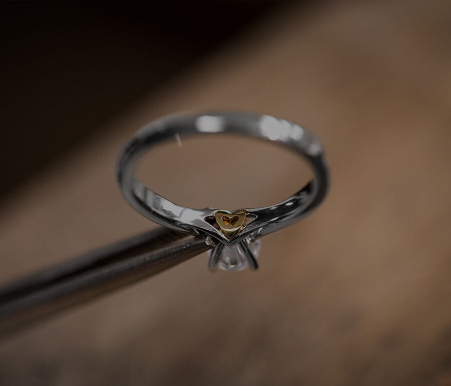 Jeweller Crafting the Ecksand Secret Gold Heart Round Cut Diamond Solitaire Engagement Ring with Secret Gold Heart