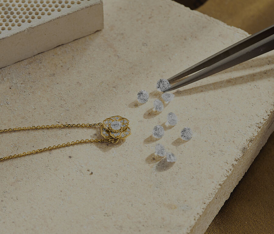 Jeweller Crafting the Ecksand Blossom Diamond Pendant Necklace in Yellow Gold in the Ecksand Atelier