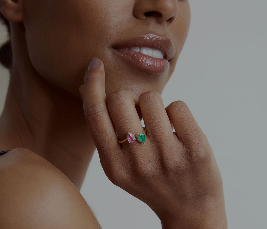 Model Wearing the Ecksand Mosaic Onyx Dangle Earrings and Ecksand Mosaic Cabochon Opal Cocktail Ring