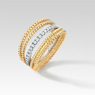 Angle View of the Ecksand Tresses Diamond Fan Cuff Ring in Yellow Gold on White Background