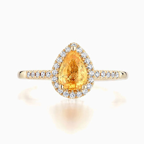 Front View of the Ecksand Pavé Pear Cut Halo Yellow Sapphire Engagement Ring with Diamond Band in Yellow Gold