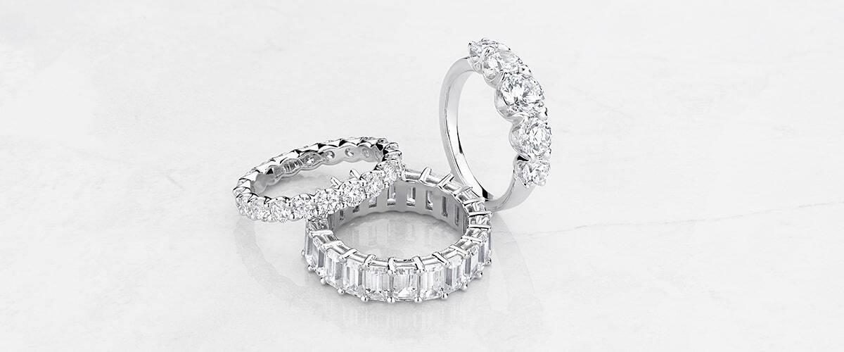 Pair of Ecksand Engagement Rings Featuring Secret Heart and Filigree Detailing in White Gold