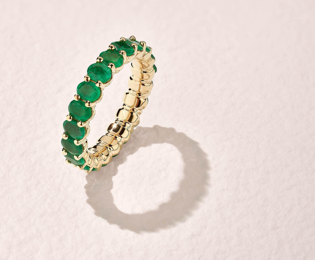 op view of Ecksand Wedding Ring with Emeralds in Yellow Gold