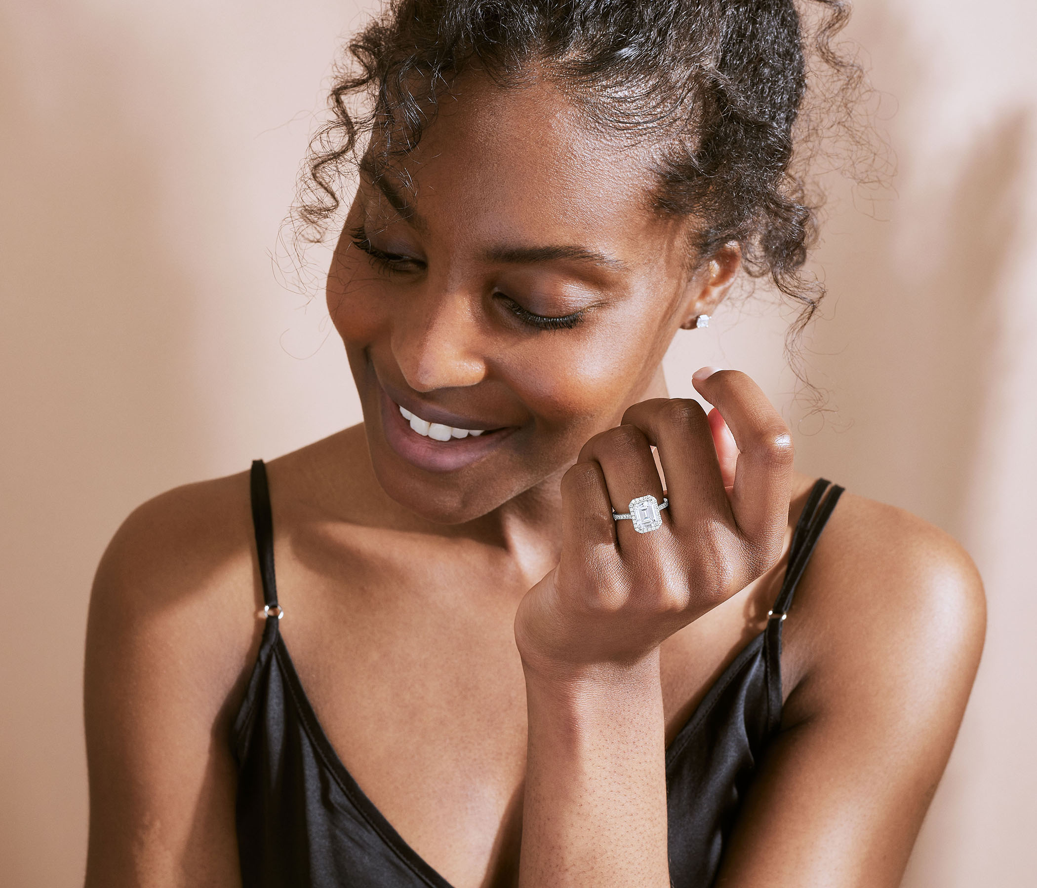 Ecksand model wearing diamond ring thinking about how a ring should fit on her finger