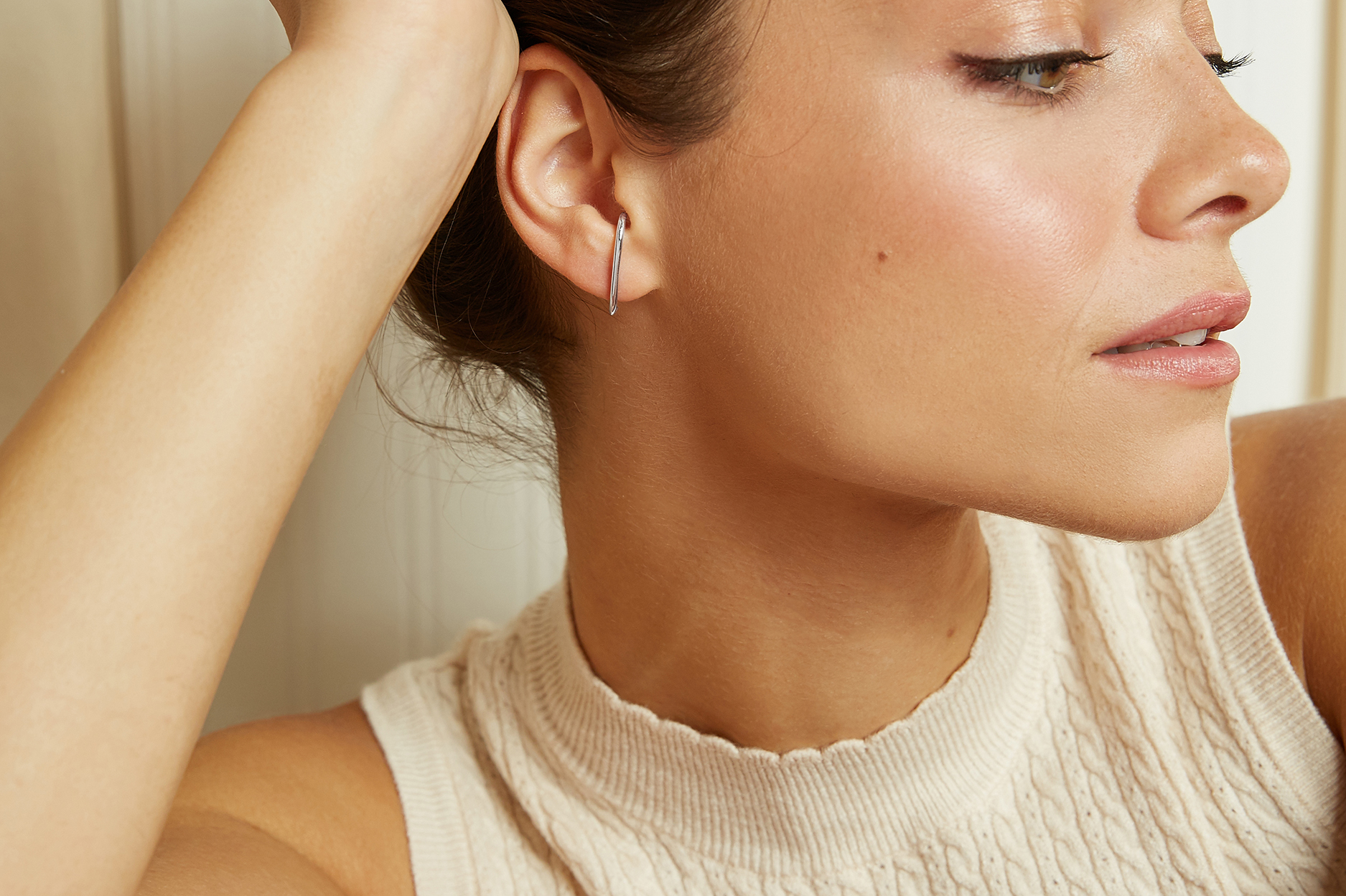 Model Wearing the Ecksand Pure Gold Bar Stud Earrings in Yellow Gold