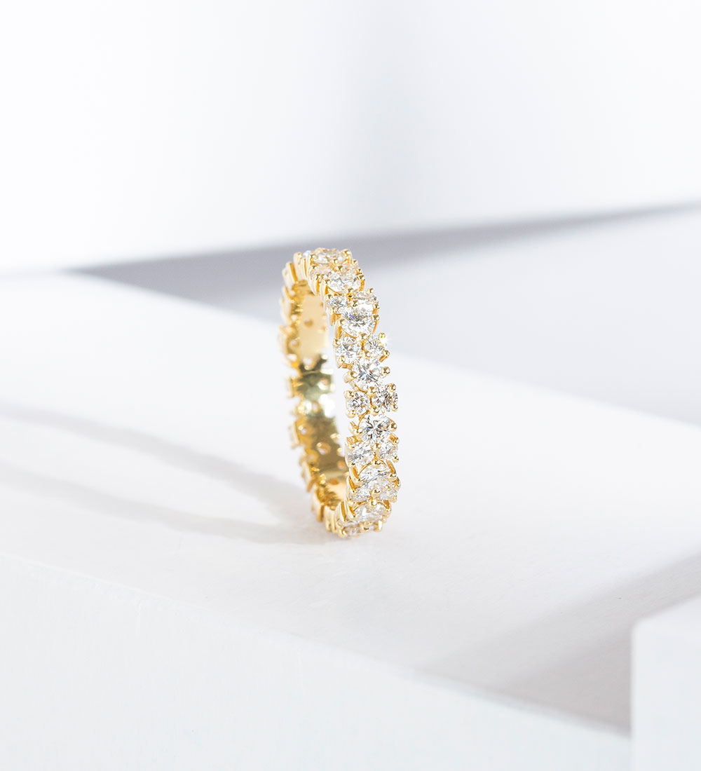 The Ecksand Blossom Diamond Eternity Wedding Band in Yellow Gold