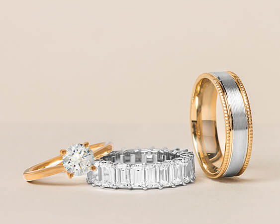 An Ecksand Bridal Ring Set Featuring the Ecksand Round Cut Diamond Engagement Ring with Filigree Motif and the Ecksand Filigree Motif Wedding Band in Yellow Gold