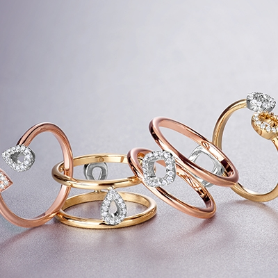 Four Ecksand Nude Rings Including the Ecksand Nude Two-Tone Double Teardrop Diamond Pavé Ring in Rose Gold, the Ecksand Nude Diamond Pavé Double Band Ring in Yellow Gold and Rose Gold, and the Ecksand Nude Two-Tone Double Circle Diamond Pavé Ring in Yellow Gold