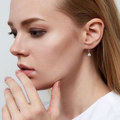 Model Wearing the Diamond and Tourmaline Ear Crawler Earrings in Yellow Gold