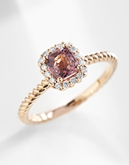 The Ecksand Tresses Cushion Cut Ruby Halo Engagement Ring in Yellow Gold