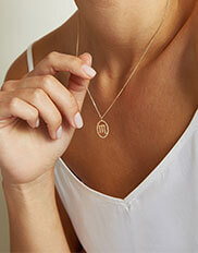 The Ecksand Tresses Gold Zodiac Necklace with Scorpio Pendant on Model