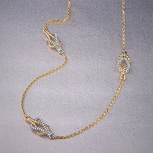 The Ecksand Tresses Diamond Triple Knot Choker Necklace in Yellow and White Gold