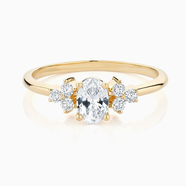 Front View of the Ecksand Trillion Cut Diamond and Sapphire Engagement Ring in Yellow Gold