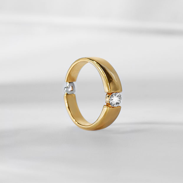 Front View of the Ecksand Secret Heart Diamond Wedding Ring with Gold Heart in Yellow Gold