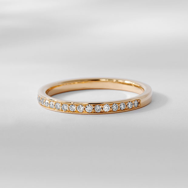 Front View of the Ecksand Bright Cut Diamond Pavé Wedding Ring in Rose Gold
